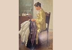 裁縫する女